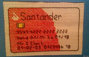 Man Cross-Stitches Debit Card